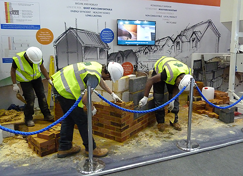 Apprentices from Grangewood Brickwork Services building demonstration corner details in brick and brickwork, arranged by MIA for the High Performance Housing feature at Ecobuild 2016, earlier in March