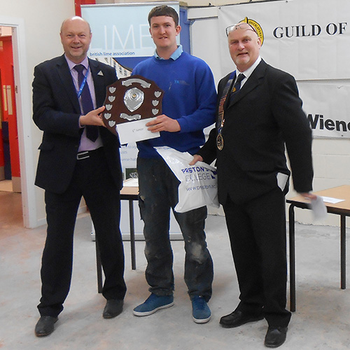 Junior winner, Matthew Cragg, is presented with his award by Kevin Burke, head of division, Preston College (left) and James Howe, president of the Guild Of Bricklayers (right),