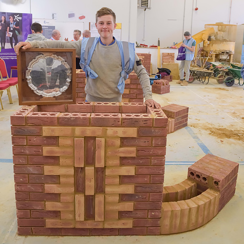 Senior category winner, Henri Couch, stands by his winning project piece after the southern heat of the Guild of Bricklayers competition, held at Fareham College.