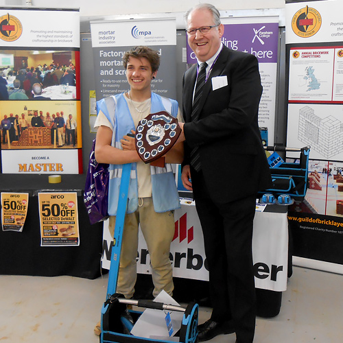 Fareham College principal and chief executive, Nigel Duncan, presents Rhys Matthews with his award as junior category winner.