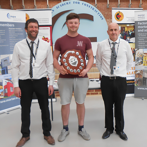 Junior winner, Arron Armstrong, Hartlepool College, being presented with his award by Gateshead College brick lecturers Mick Robinson (left) and Paul Briggs.