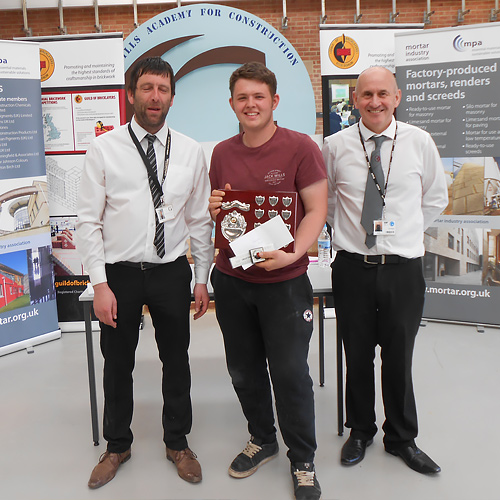 Senior category winner, Henri Couch, receives his award from Fareham College principal and chief executive, Nigel Duncan.