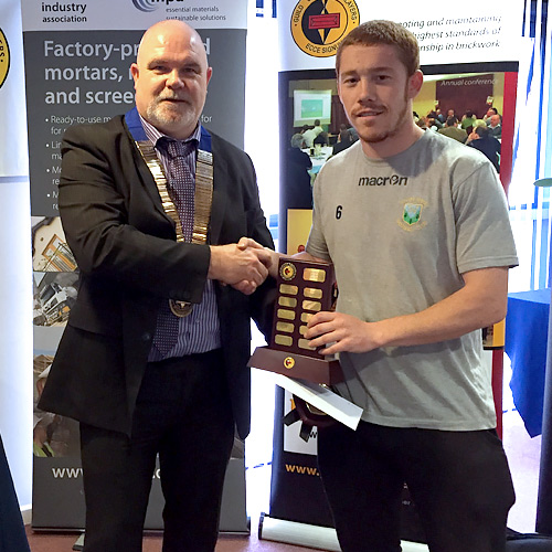 Wales competition junior winner, Liam McGinley (NPTC Swansea) receives his award from Guild of Bricklayers president, Phil Vine-Roberts
