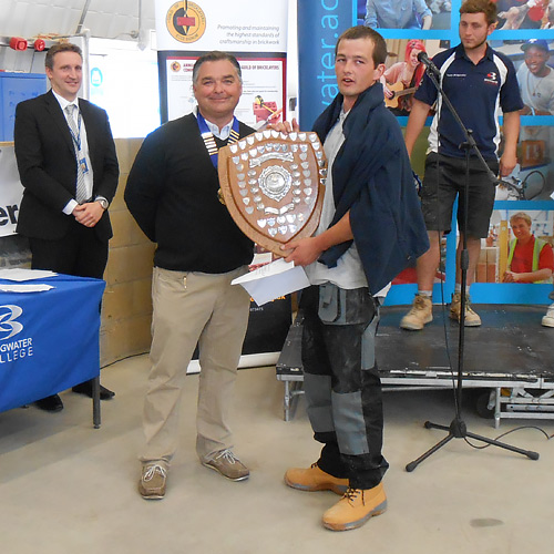 Senior winner of the western competiton, Matt Sandry, (Cornwall College) accepts his award from western competition secretary, Andy Ballard
