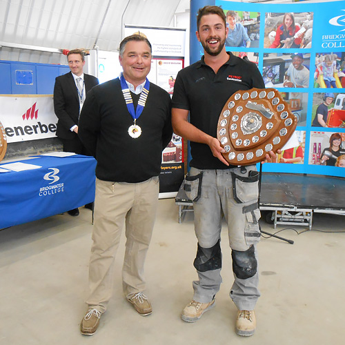 Andy Ballard, western competition secretary, presents his division's junior winner, Ben Lawson (PETROC), with his award