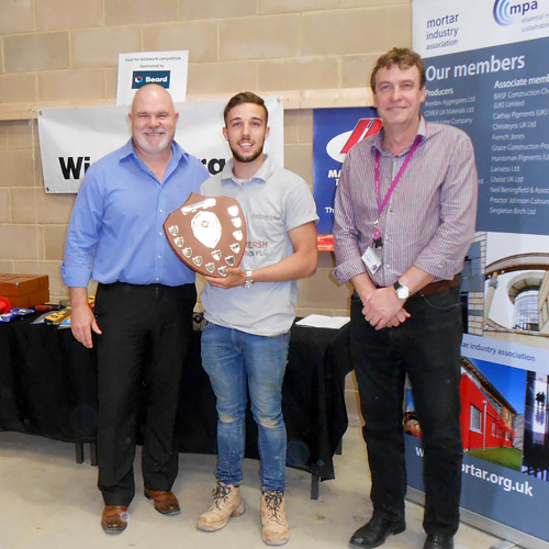 Connor Honeyman of Barking and Dagenham College receives his award for the senior competition from Guild of Bricklayers president, Phil Vine-Roberts (left) and the Brooklands College head of construction, Neil Houldey
