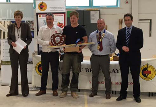 Junior heat winner, Lewis Greenwood, receives his awards from (left to right) Alison Birkinshaw principal, York College, Guy Armitage, York Handmade Bricks, sponsor, Charlie Young, Andrew Bannister, Yorkshire section guild chairman and Richard Urwin, Mitchell and Urwin, sponsor