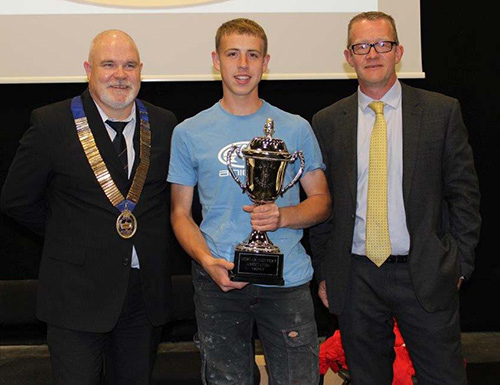 National senior category winner, Jordan Richards of Derby College, receives his trophy from Guild of Bricklayers president, Phil Vine Roberts (left) and CPI Euromix's Stuart Russell who supplied the mortar for the competition