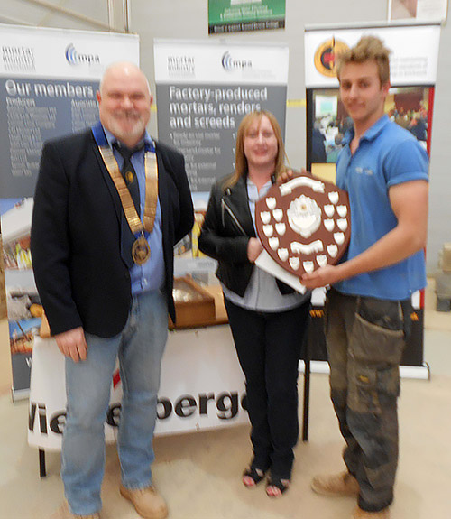 Stephen Tate of Sussex Downs College receives his senior category award from president of the Guild of Bricklayers, Phil Vine Roberts and Veronica Diett, wife of Kevin Diett, lecturer in charge of brickwork at Sussex Downs College, who died last year.