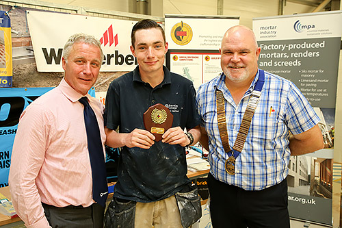 Junior section finals winner, Morgan Chambers, Barnsley College, is presented with his award by Tarmac Building Products' Iain Betts (left) and guild president, Phil Vine Roberts.