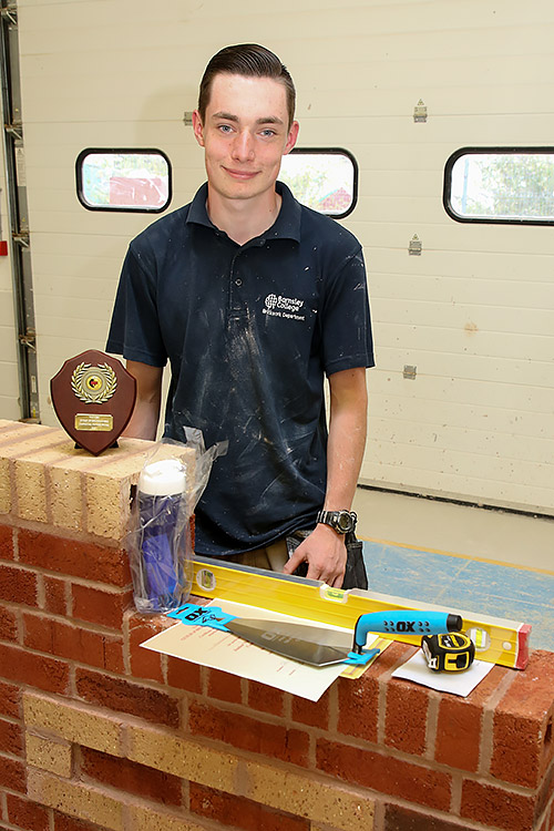 Barnsley College's Morgan Chambers, standing in front of his winning work piece, shows off his awards for winning the junior section.