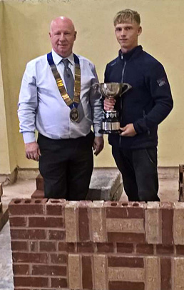 Guild of Bricklayers president, Kevin Harold, with junior section winner of the Notts/Lincoln heat, William Austin