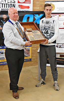 London senior heat winner, Joseph Ritchie, receives his award from Guild of Bricklayers president, Kevin Harold