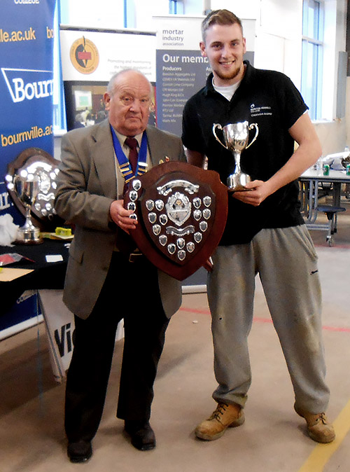 Guild of Bricklayers West Midlands chairman, Vic Scriven, presents the junior section awards to Connor Keyte of Morton Morrel College.